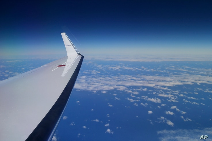 Japan Coast Guard's Gulfstream V aircraft flies in the search zone for debris from the missing Malaysia Airlines flight MH370, April 1, 2014 off Perth, Australia.