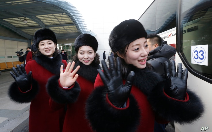 North Korean cheering squads wave upon their arrival at the Korean-transit office near the Demilitarized Zone in Paju, South Korea, Feb. 7, 2018.