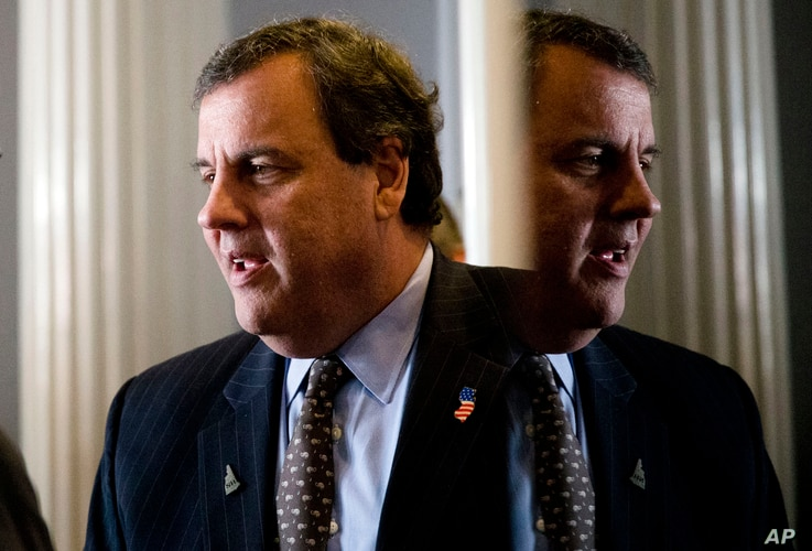 Republican presidential candidate, New Jersey Gov. Chris Christie talks as he meets with a supporter before a news conference, Jan. 25, 2016, in Concord, N.H.