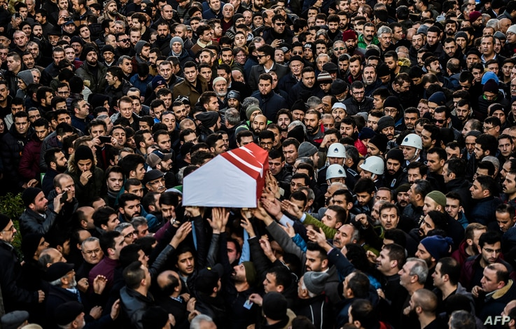People carry the coffin of Yunus Gormek, 23, one of the victims of the Reina night club attack, during his funeral ceremony, Jan. 2, 2017 in Istanbul. The Islamic State jihadist group on January 2, 2