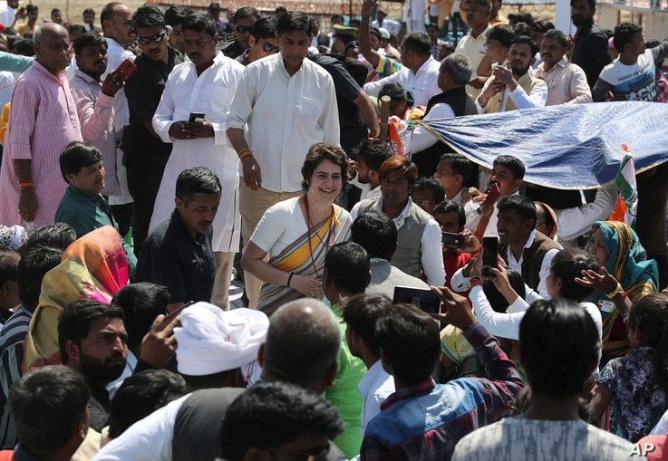 Congress party General Secretary Priyanka Gandhi Vadra meets supporters as she arrives at Assi Ghat in Varanasi, India, March 20, 2019.