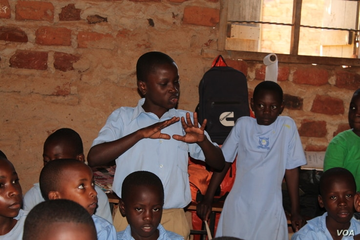 An upper primary male student of Parents Care Infant Academy answers a question on reusable sanitary towels in Makindye, Kampala Uganda.
