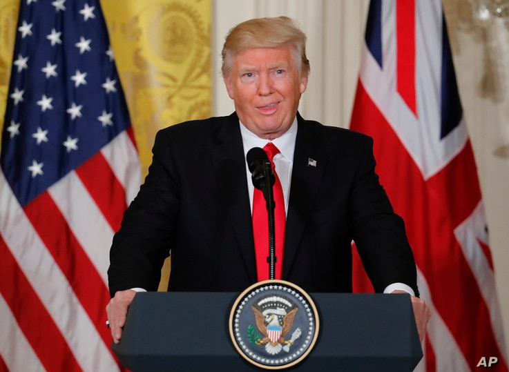 President Donald Trump reacts to a question from a members of the media during a joint news conference with British Prime Minister Theresa May in the East Room of the White House White House in Washington, Jan. 27, 2017.