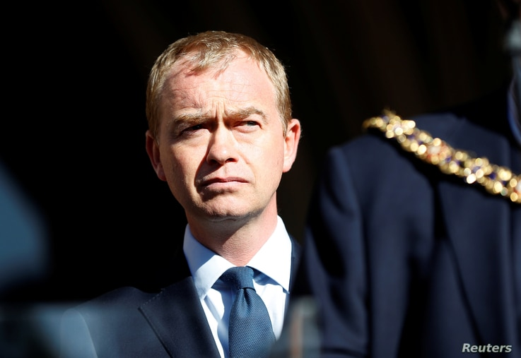 Tim Farron, the leader of Britain's Liberal Democrat Party, takes part in a vigil for the victims of an attack on concertgoers at Manchester Arena, in central Manchester, England,  May 23, 2017.