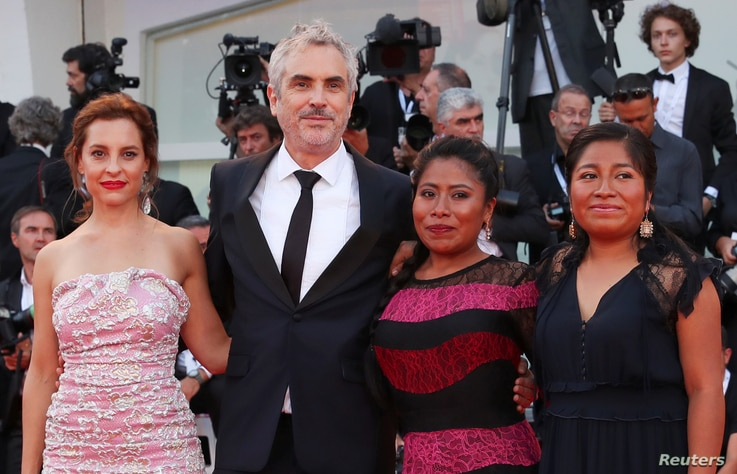 """Director Alfonso Cuaron with actors Yalitza Aparicio, Nancy Garcia and Marina de Tavira, pose on the red carpet upon arriving at the  75th Venice International Film Festival for the screening of the film """"Roma,"""" Aug. 30, 2018."""