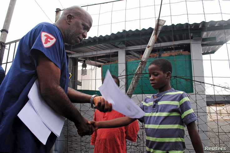Moses Duo, 9, receives a certificate for being cured of the Ebola virus in Paynesville, Liberia, July 20, 2015.