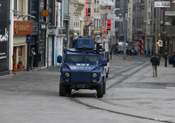 An armored police vehicle drives along an empty Istikal street, following a suicide bombing in a major shopping and tourist district in central Istanbul, March 19, 2016.
