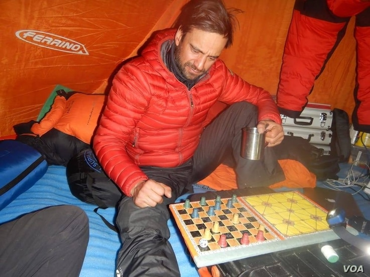 This photo of Daniele Nardi, playing a game while sheltered in his tent, was posted on his Facebook page.