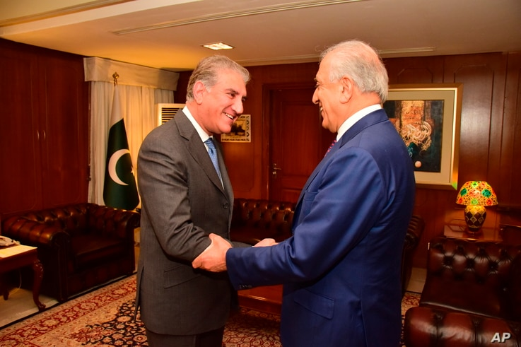 In this photo released by the Foreign Office, Pakistan's Foreign Minister Shah Mahmood Qureshi (L) receives U.S. envoy Zalmay Khalilzad at the Foreign Ministry in Islamabad, Pakistan, Jan. 18, 2019.