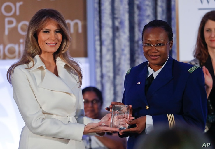 First lady Melania Trump presents the 2017 Secretary's of State's International Women of Courage (IWOC) Award to Major Aichatou Ousmane Issaka, from Niger,  March 29, 2017, at the State Department in Washington.