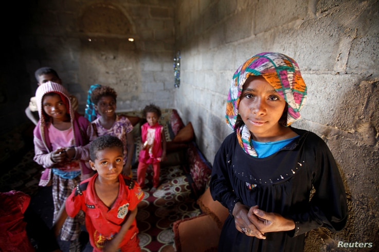 Children displaced from the Red Sea port city of Hodeida stand in their shelter in Sanaa, Yemen, Nov. 1, 2018.