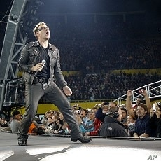 Lead singer Bono of Irish rock band U2 performs during their 360 Degree Tour (file photo)