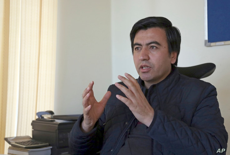 Abdul Wadood Pedram, of the Kabul-based Human Rights and Eradication of Violence Organization, gives an interview to The Associated Press in Kabul, Afghanistan, Feb. 8, 2018.