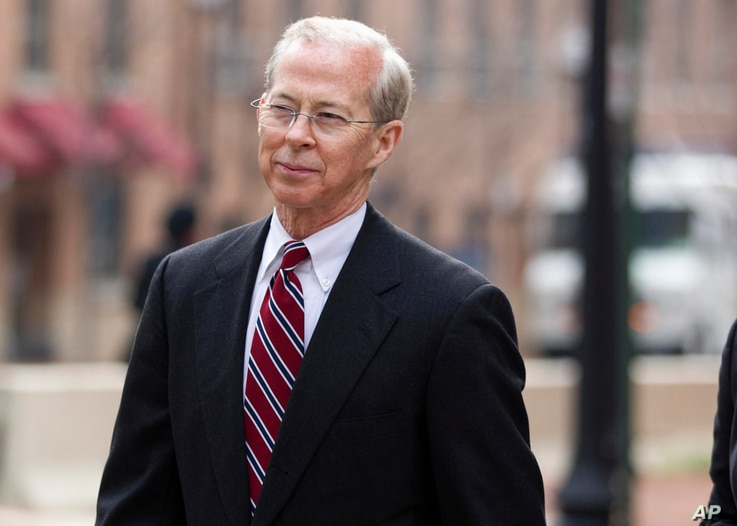 FILE - Dana Boente, then-First Assistant U.S. Attorney for the Eastern District of Virginia leaves federal court in Alexandria, Va. He became acting attorney general when President Donald Trump fired Sally Yates.