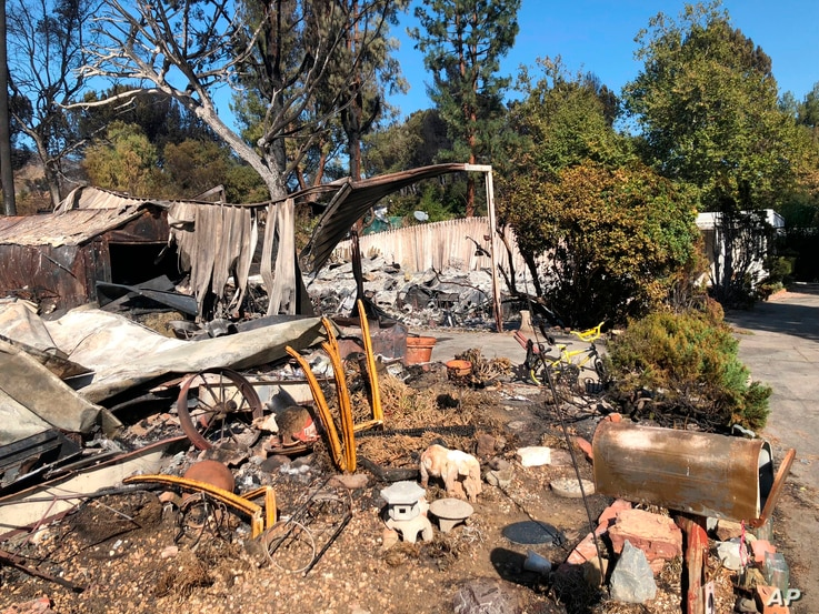 Charred property is seen in the Seminole Springs Mobile Home Park, Nov. 11, 2018, after a wildfire tore through the area in Agoura Hills, California.