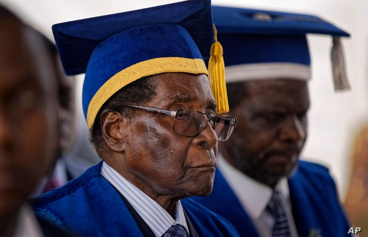 Zimbabwe's President Robert Mugabe leaves after presiding over a student graduation ceremony at Zimbabwe Open University on the outskirts of Harare, Zimbabwe, Nov. 17, 2017.