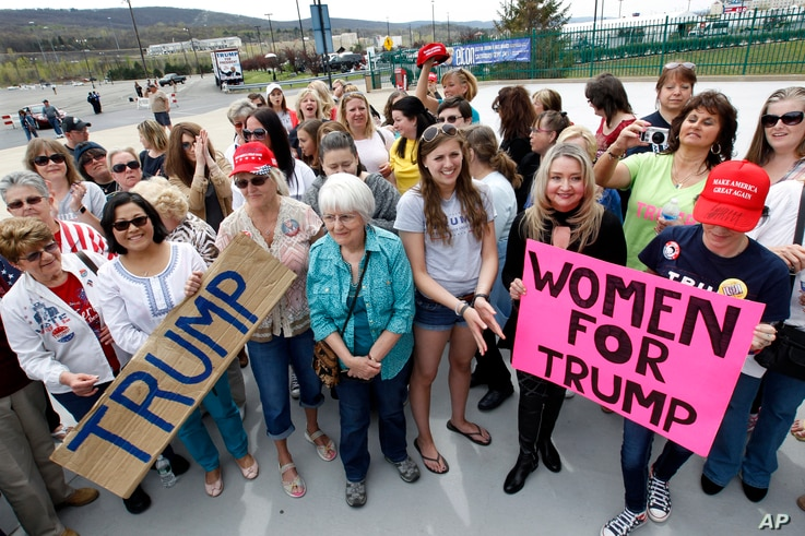 FILE - A group of women hold signs and shout their support as they wait on line to attend a Republican presidential candidate, Donald Trump campaign rally, in Wilkes-Barre, Pa., April 25, 2016.