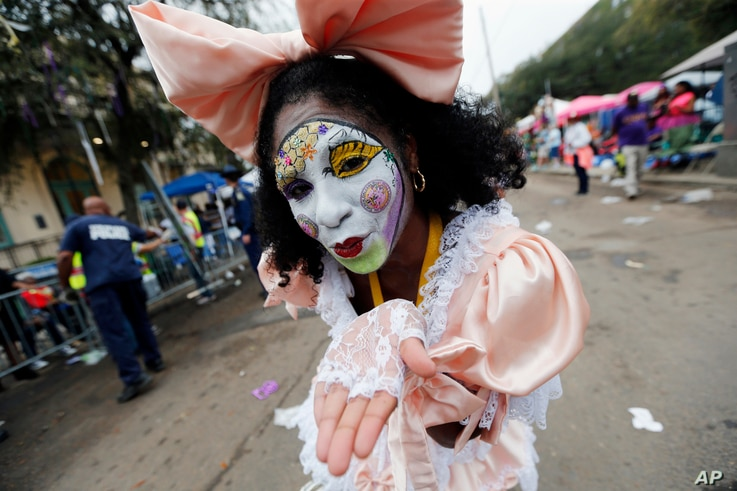 A member of the New Orleans Baby Doll Ladies walks down St. Charles Avenue ahead of the Zulu Parade during Mardi Gras in New Orleans, Feb. 28, 2017.