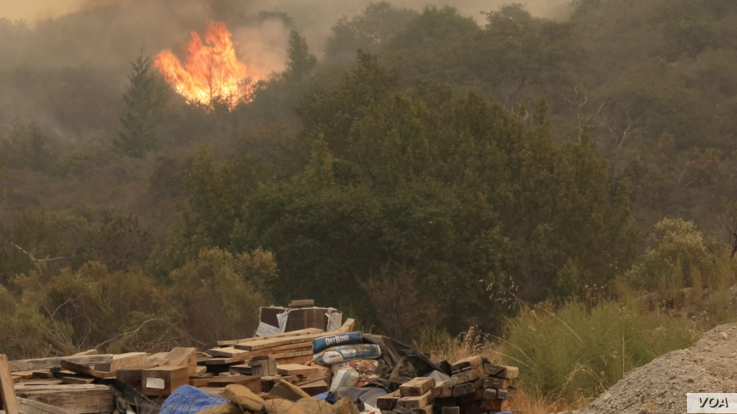 As wildfires continue to spread in Sonoma County,  Calif., Oct. 12, 2017, people are either fleeing or returning to neighborhoods that may have been spared.