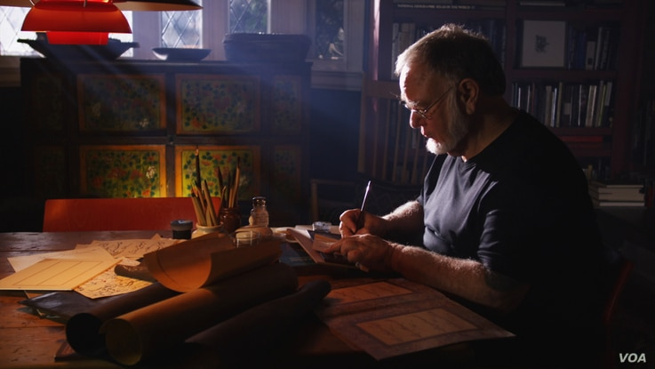 Master calligrapher Mohamed Zakariya practices his art at his home in California (courtesy Unity Productions Foundation)
