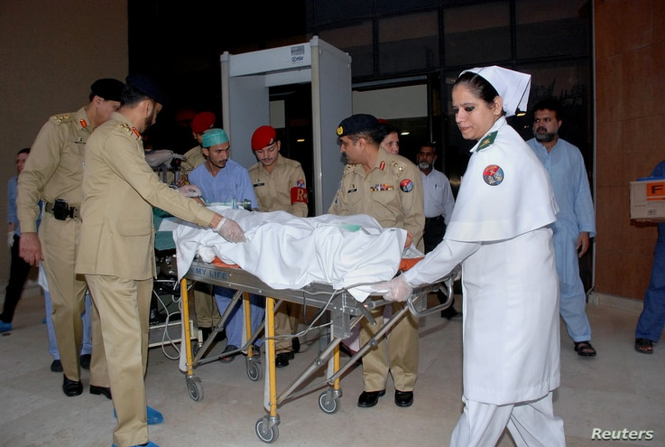 In this photo released by Inter Services Public Relations Department, Pakistani army doctors and medical staff transport 14-year-old schoolgirl Malala Yousufzai, who was shot last Tuesday by the Taliban, to transfer her from a military hospital to th...