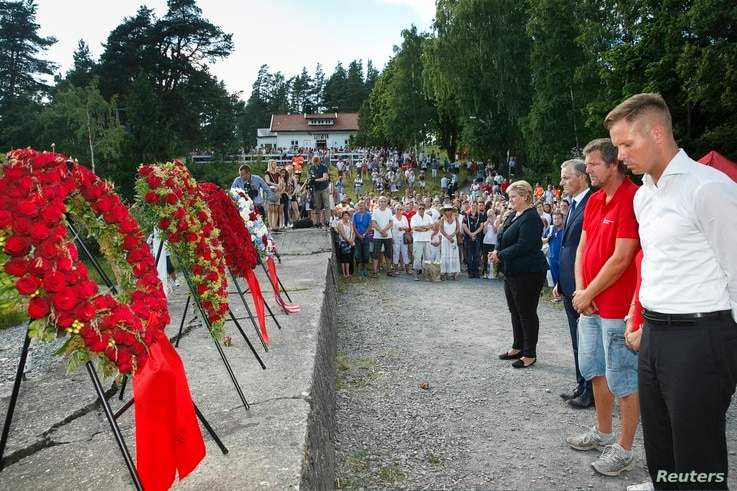 From left, Norway's Prime Minister Erna Solberg, Labor Party leader Jonas Gahr Stoere, National Support Group's leader Trond Henry Blattmann and leader of Labor Youth of Norway (AUF) Eskil Pedersen take part in a wreath laying ceremony on Utoya Islan...