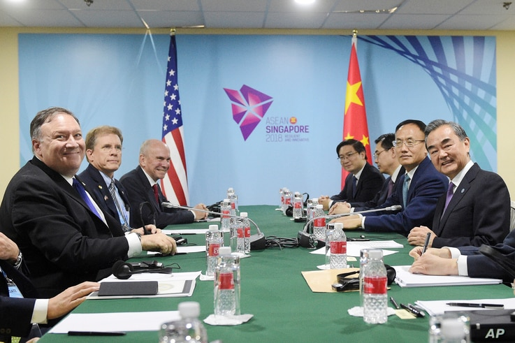U.S. State Secretary Mike Pompeo, left, and China's Foreign Minister Wang Yi, right, at a bilateral meeting on the sidelines of the 51st ASEAN Foreign Ministers Meeting in Singapore, Aug. 3, 2018.