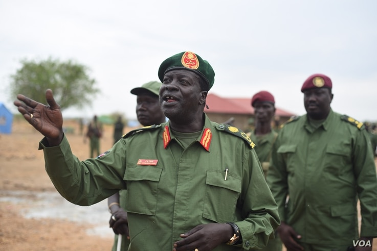 Rebel General James Koang speaks to the press at the rebels' base on the outskirts of Juba, South Sudan, April 7, 2016. The rebels are returning to secure the city ahead of the arrival of their leader, Riek Machar, on April 18.