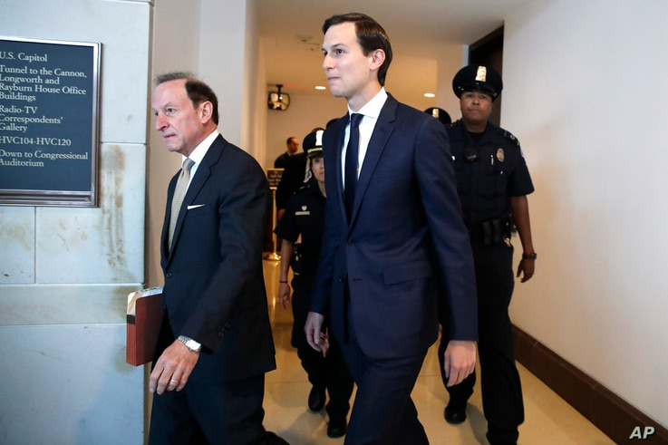 White House adviser Jared Kushner, center, and his attorney Abbe Lowell, left, arrive on Capitol Hill in Washington to be interviewed behind closed doors by the House Intelligence Committee, July 25, 2017.