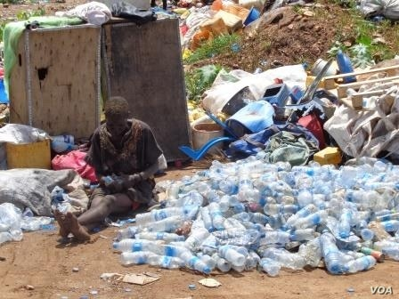 A South Sudanese woman sorts through plastic bottles she collected at a landfill outside Juba. Around 1 million plastic bottles are disposed of every day in the South Sudanese capital.