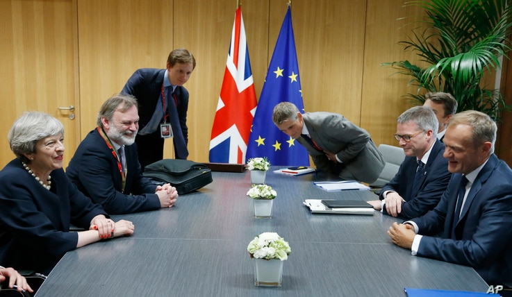 European Council President Donald Tusk, right, meets with British Prime Minister Theresa May, left, during a bilateral meeting on the sidelines of an EU summit in Brussels, Belgium, June 22, 2017.