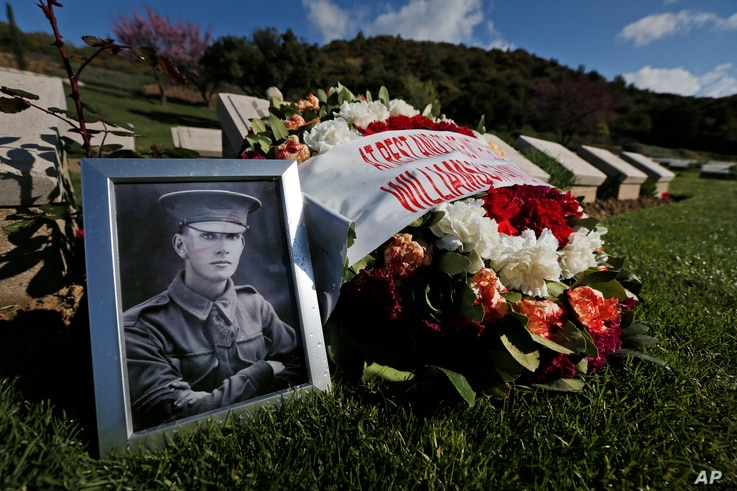 The family of Australian Sgt. D. M. Williamson, killed May 3, 1915, placed tributes on his grave in Turkey's Shrapnel Valley cemetery, April 23, 2015. Nearly 700 Allied servicemen killed during the Gallipoli campaign are buried there.