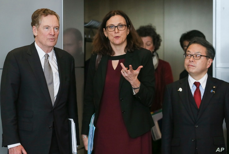 EU Commissioner for Trade Cecilia Malmstroem, center, Japanese Minister for Economy, Trade and Industry Hiroshige Seko, right, and US Trade Representative Robert Lighthizer, pose for photographers prior to a meeting at EU headquarters in Brussels,  M...