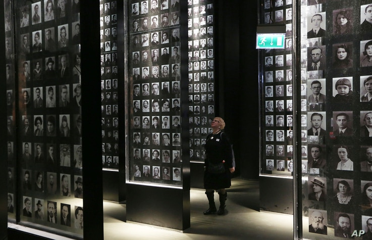 A visitor looks at an exhibit in the Museum of the Second World War, an ambitious new museum under creation for nine years has opened its doors for a day to historians, museums and reporters in Gdansk, Poland, Jan. 23, 2017.
