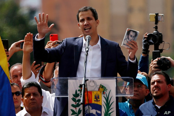 Juan Guaido, head of Venezuela's opposition-run congress, declares himself interim president of Venezuela, during a rally demanding President Nicolas Maduro's resignation in Caracas, Venezuela, Jan. 23, 2019.
