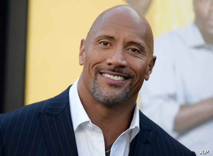 """FILE - Actor Dwayne Johnson attends the premiere of his film """"Central Intelligence"""" in Los Angeles, June 10, 2016. Johnson's income has swelled from upfront fees for """"Central Intelligence"""" and """"Fast 8,"""" as well as the forthcoming """"Baywatch,"""" Forbes m..."""