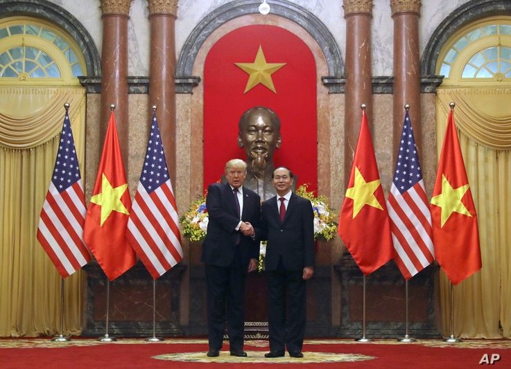 President Donald Trump and Vietnamese President Tran Dai Quang pose for photographers at the Presidential Palace, Nov. 12, 2017, in Hanoi, Vietnam. Trump is on a five country trip through Asia traveling to Japan, South Korea, China, Vietnam and the P...