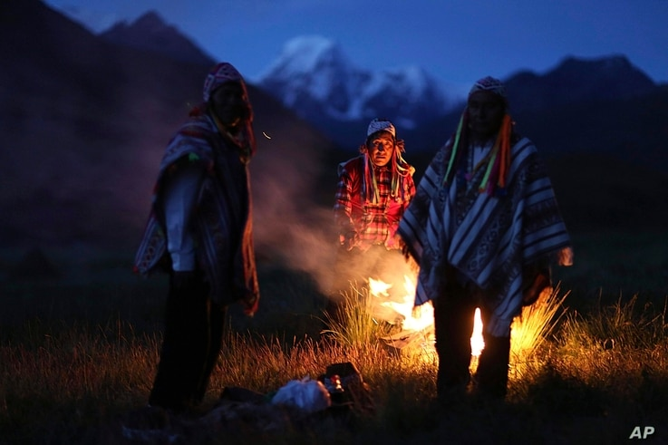 Andean farmers take part in a ceremony honoring Mother Earth and Father Snowy Mountain, in Pitumarca, Peru, April 4, 2018.