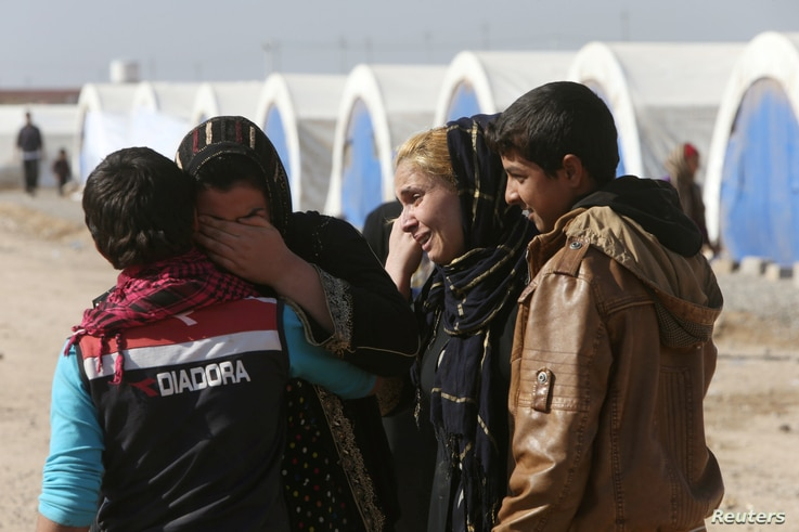 Displaced Iraqis, who fled the Islamic State stronghold of Mosul, meet their relatives in Khazir Refugee Camp, east of Mosul, Iraq Nov. 5, 2016.