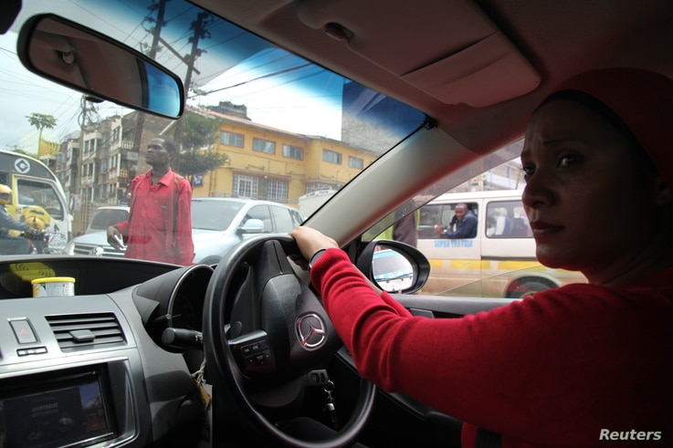 Faridah Khamis, 36, single mother of five children drives her cab through the streets of Nairobi, Kenya, April 19, 2018.