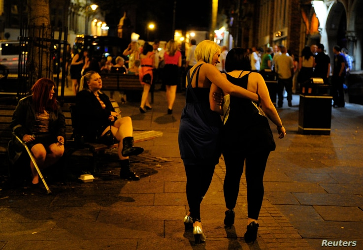 FILE - Two women are seen enjoying a night in town. Alcohol and and substance abuse have been identified as contributors to an increased mortality rate among white women in the United States.
