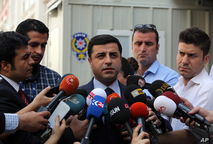 Pro-Kurdish Peoples' Democracy Party leader Selahattin Demirtas speaks to the media about Turkey's airstrikes against Kurdish rebel bases in Iraq, in Ankara, Turkey, July 27, 2015.