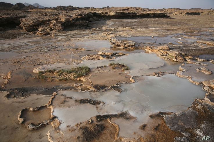 Travertine pools with white films of carbon fused with calcium are shown in the al-Hajjar mountains of Oman, March 5, 2017.