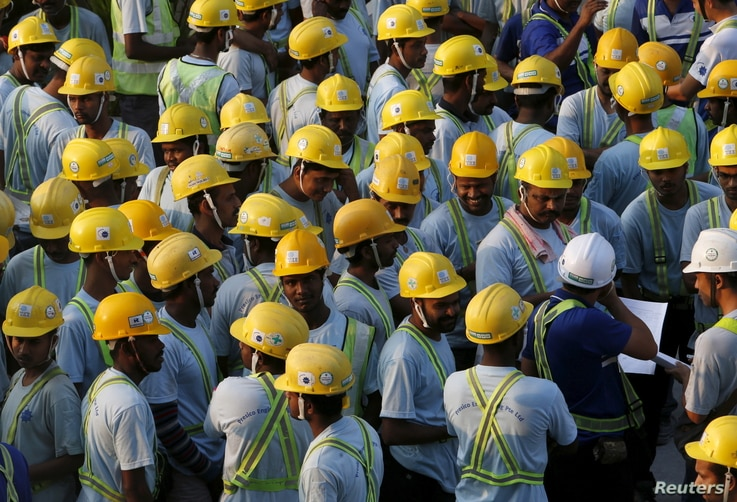 Construction workers from Bangladesh and India attend a briefing before starting work at a construction site in Singapore, March 24, 2016.