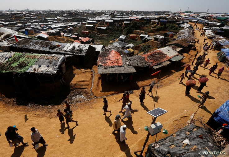Rohingya refugees walk through the Kutupalong refugee camp area, near Cox's Bazar, Bangladesh, Nov. 6, 2017.
