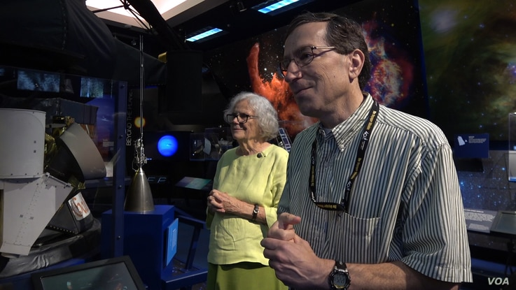 """Sue Finley and colleague Steven Lichten both work for NASA's Deep Space Network, which provides communication with space probes. Licten says colleagues regard the six-decade NASA employee as a kind of """"guru."""" (MO'Sullivan/VOA)"""