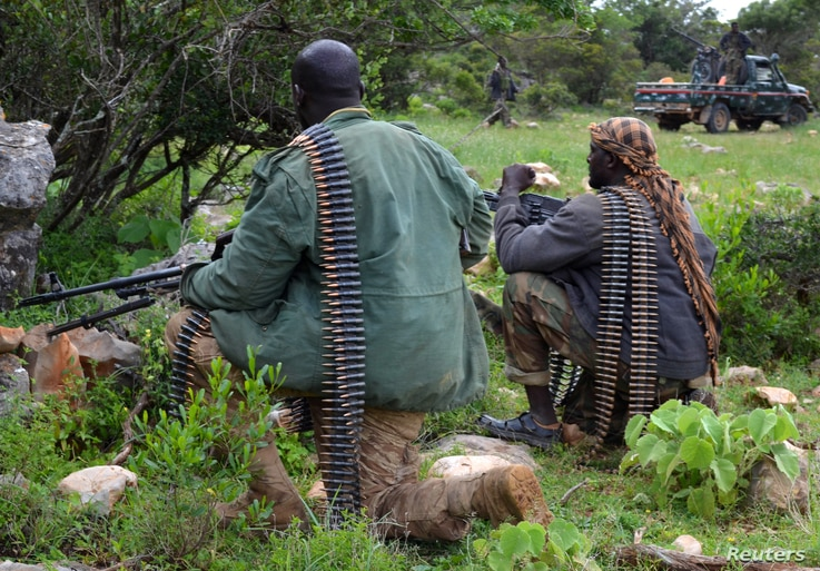 Soldiers from Somalia's Puntland keep guard on high grounds at the Galgala hills, during preparations for an offense against al-Shabaab militants, north of the capital Mogadishu, Jan. 9, 2015.
