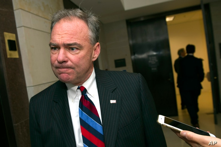 Sen. Tim Kaine, D-Va., speaks with a reporter as he arrives for a classified briefing by Secretary of State John Kerry on Iran, on Capitol Hill in Washington, July 22, 2015.