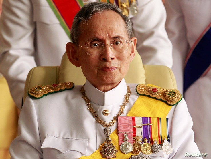 FILE - Thailand's King Bhumibol Adulyadej leaves the Siriraj Hospital for a ceremony at the Grand Palace in Bangkok.