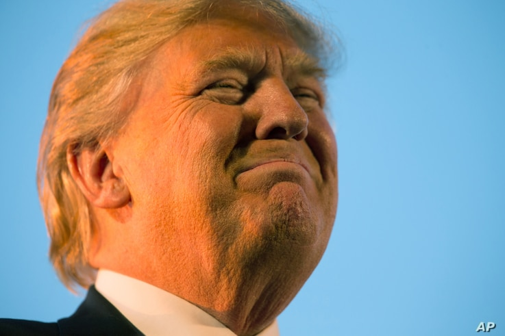 FILE - Then-presidential candidate Donald Trump pauses during while speaking at a rally in Millington, Tenn., Feb. 27, 2016. Tough talk about torture was a guaranteed applause line for Trump on the GOP presidential stump.